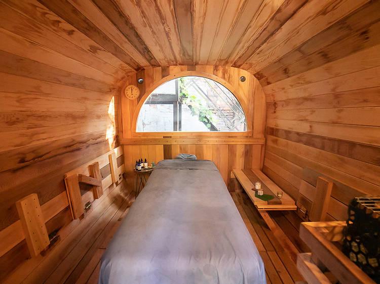 Escape into a backyard sauna at cityWell Brooklyn