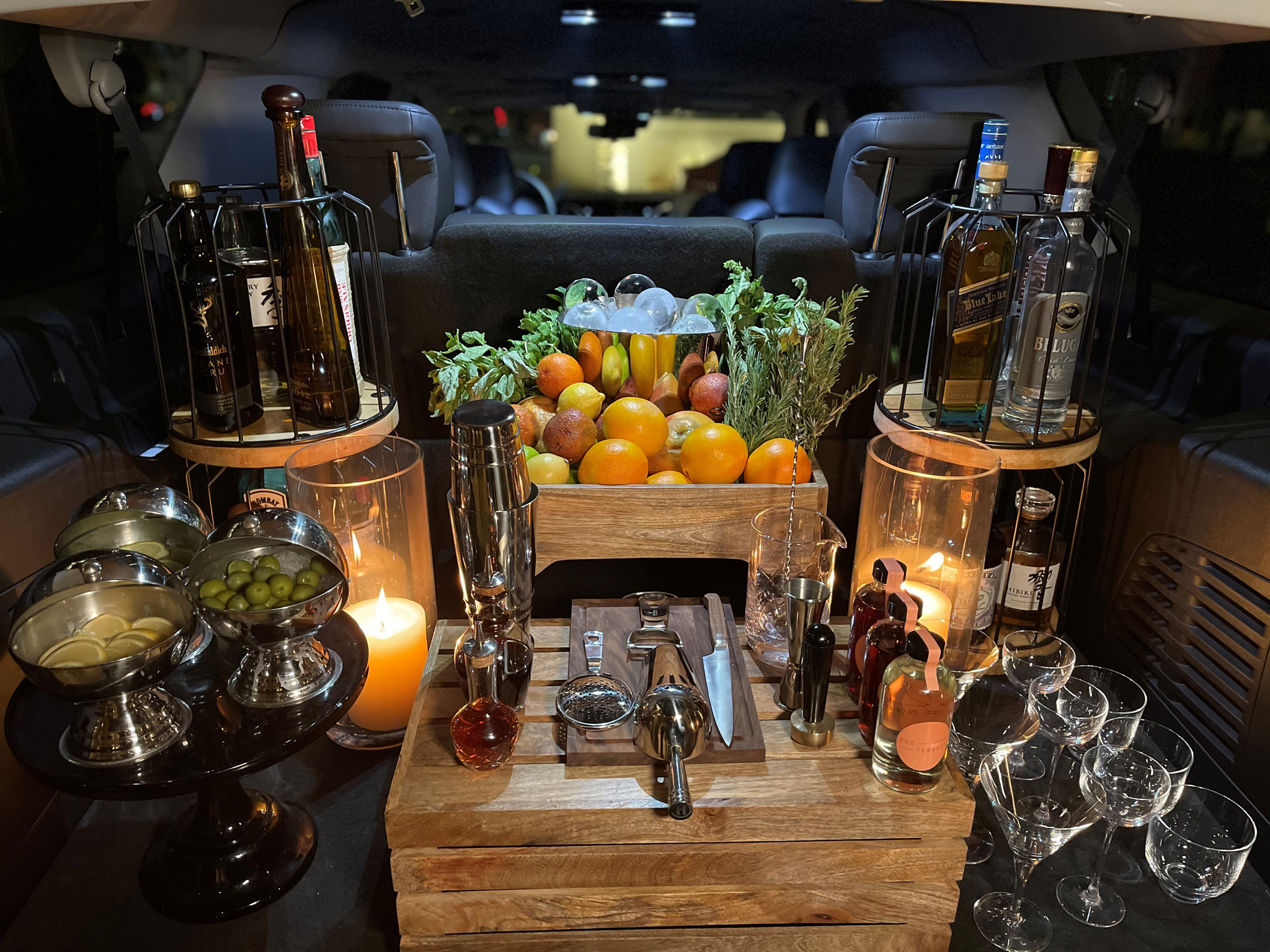 Need a stiff drink? This new mobile bar cart mixes cocktails at your door, distanced and masked.