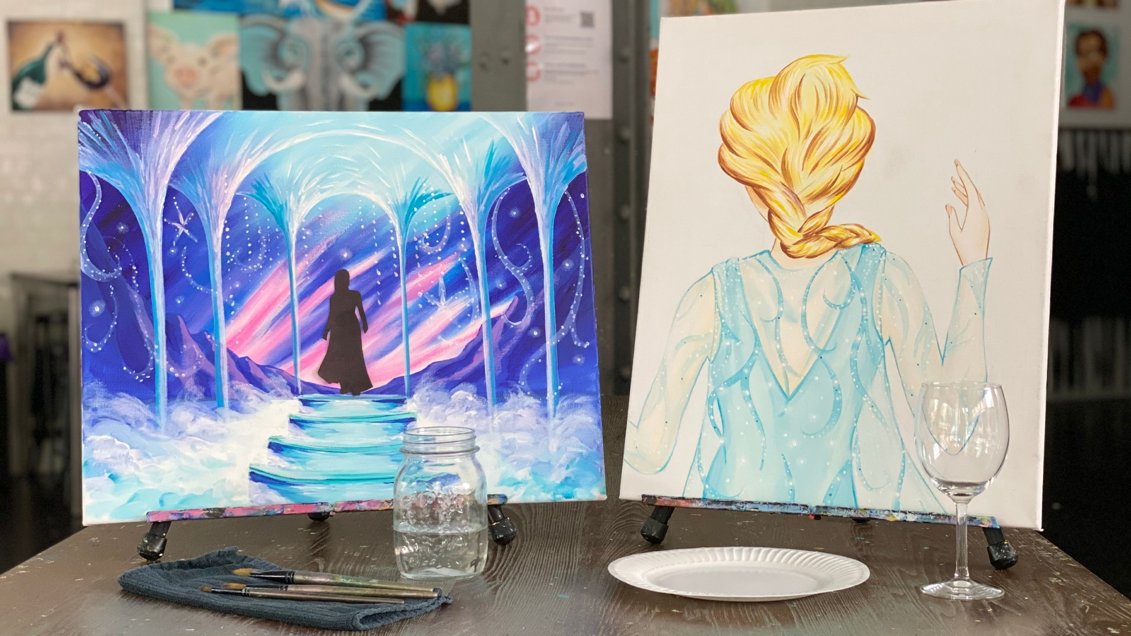 Two canvases with Frozen the Musical scenes painted