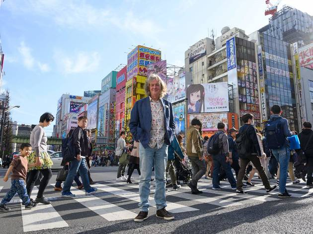 James May stands on a crowded street crossing in Japan