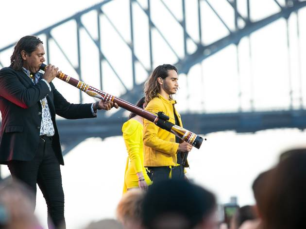 William Barton plays didgeridoo with Sydney Harbour Bridge in background