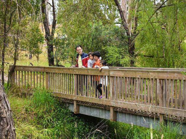 A family on a bridge at Westerfolds Park
