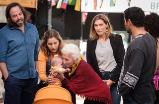 The two main families of bump congregate around the baby's pram, with actor Nathalie Morris at the centre as Olympia and coc-creator Claudia Karvan to one side as her mum Angie