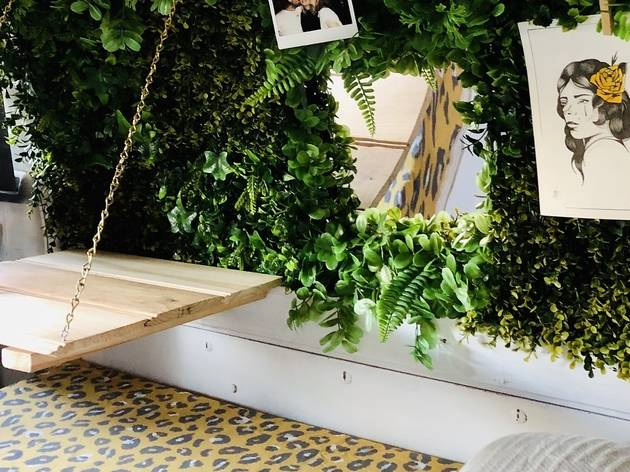 Interior of campervan with plant wall and drop down table