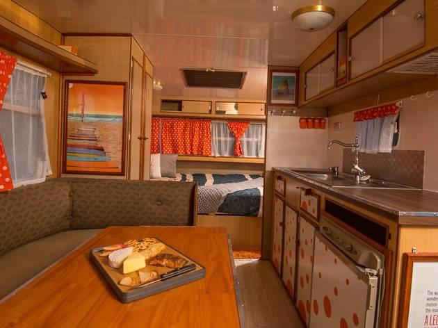 Interior of caravan with orange polka dot details