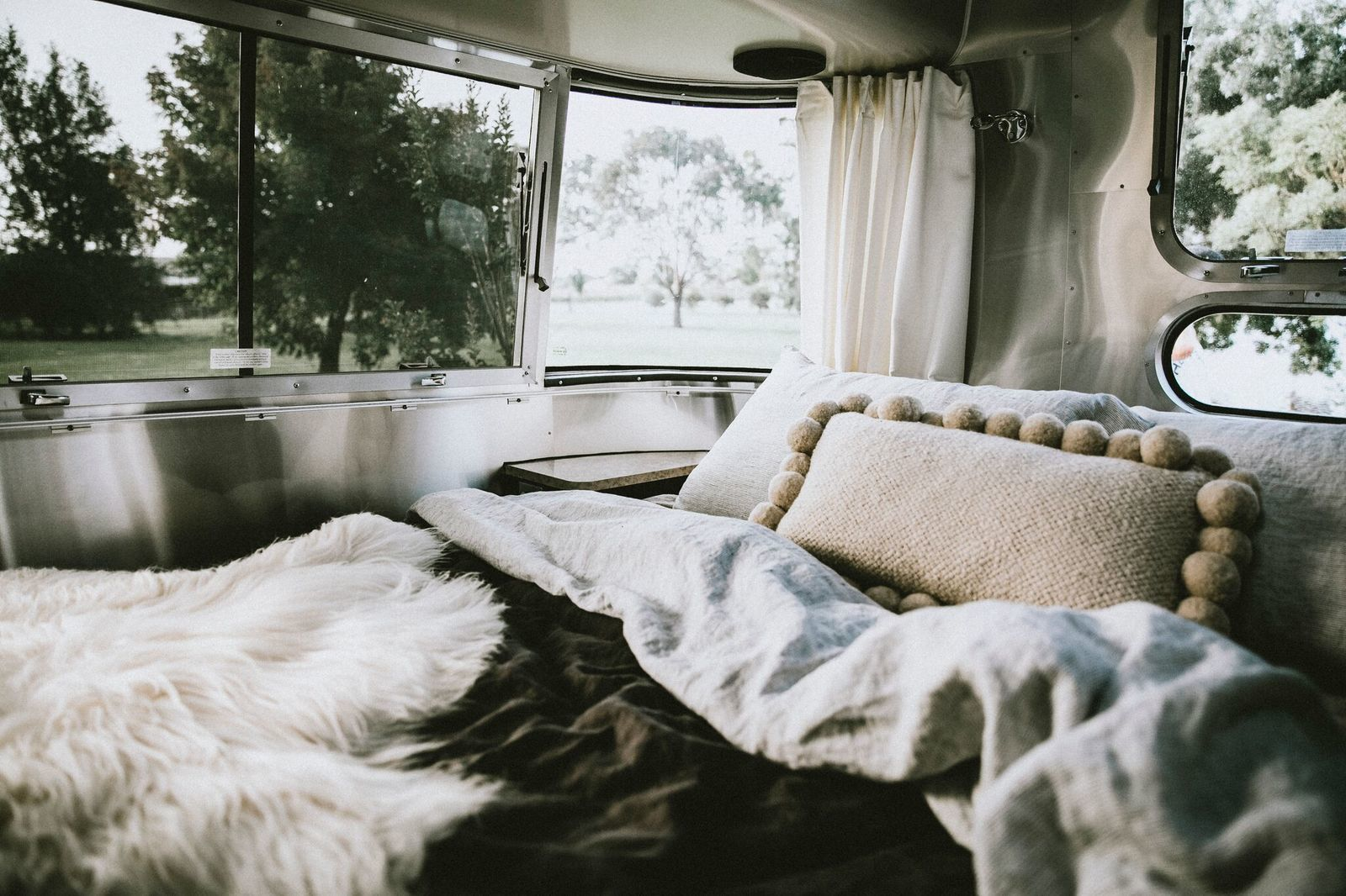 Interior of caravan with bed and windows