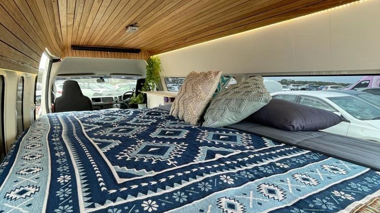Interior of campervan with wood panel ceiling