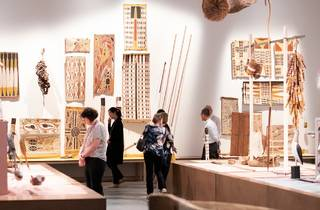 Visitors wander through exhibition of Aboriginal art