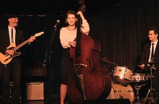 Mary Heart with playing double bass in her three-piece band