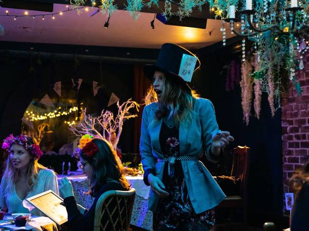 a woman dressed as Alice at Wonderland Bar