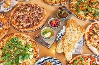 Pizzas and garlic bread