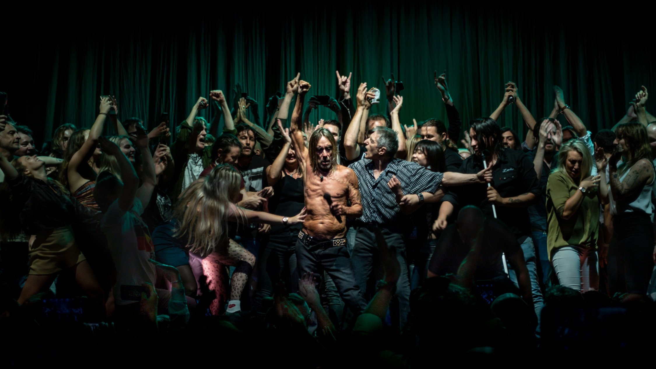 Iggy Pop parties in a wild party scene shot like an old religious oil painting by photographer Antoine Veling