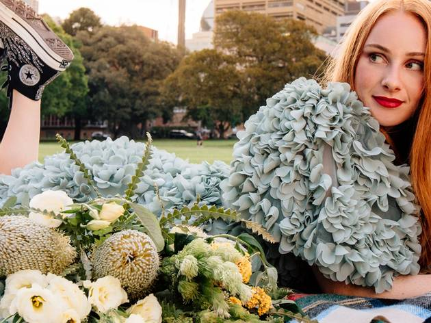 Singer Vera Blue on a picnic blanket in the Domain
