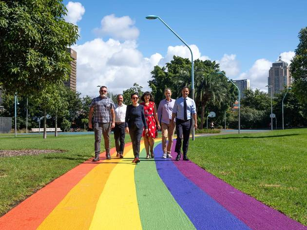 Leigh Harris, Mike Galvin, deputy lord mayor Jess Scully, lord mayor Clover Moore, Orlando Sydney and Alex Greenwich walk on the new rainbow crossing.