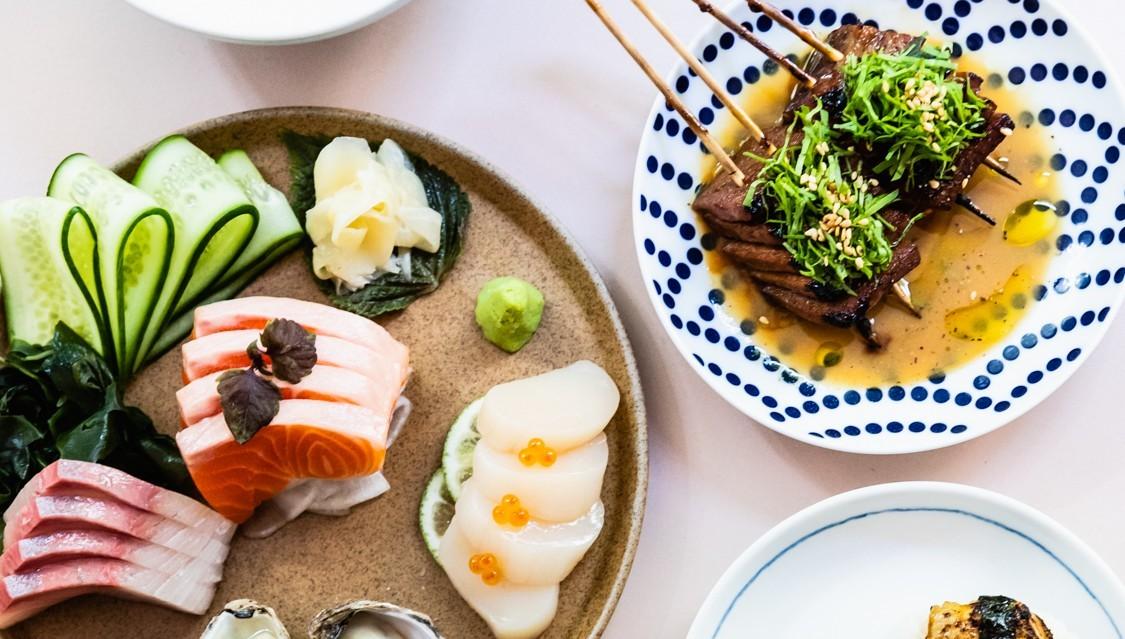 Plates of sashimi and skewers