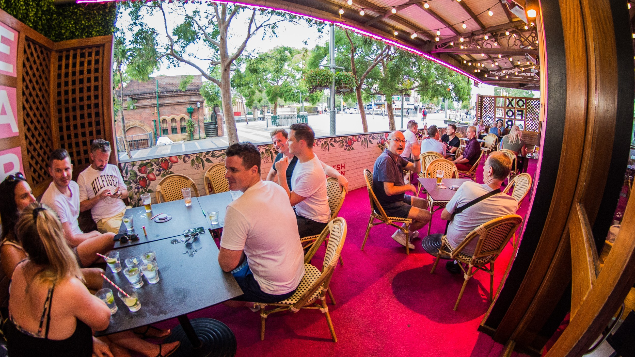 People gather in the outdoor seating area at the Oxford Hotel.