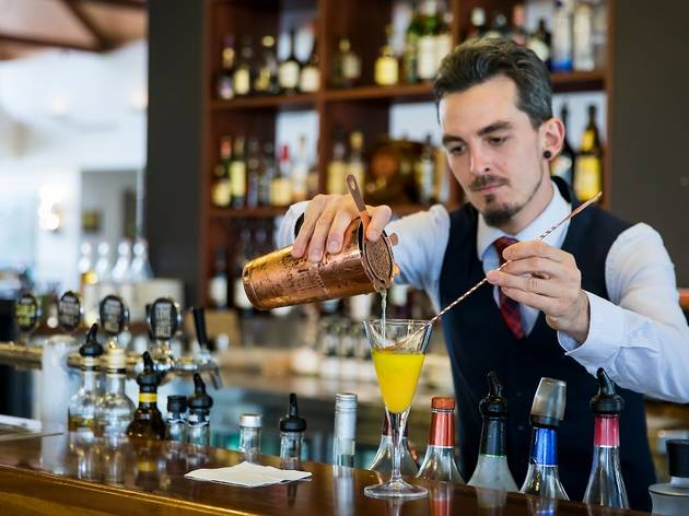 A bartender mixing a cocktail