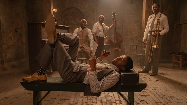 Ma Rainey's Black Bottom (2020): (L to R) Chadwick Boseman as Levee, Glynn Turman as Toldeo, Michael Potts as Slow Drag, Colman Domingo as Cutler. Cr. David Lee / Netflix