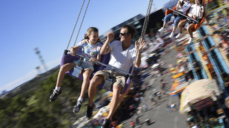 Adult and child ride on swinging chairs ride