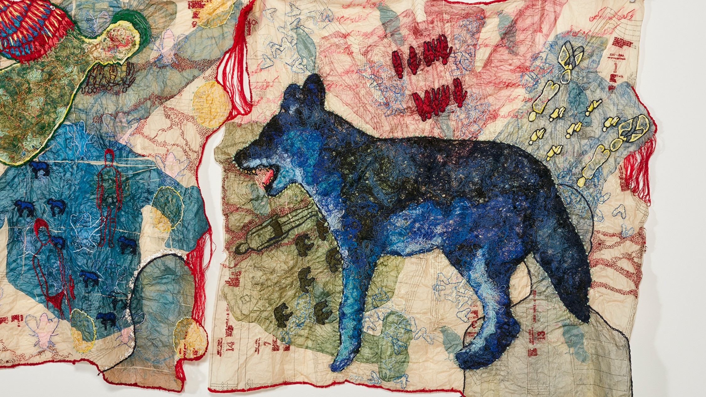 A beautiful tapestry depicting a blue dingo against a collage of images