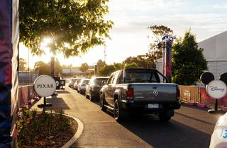 A queue of cars waiting to get into the Disney+ Drive-In