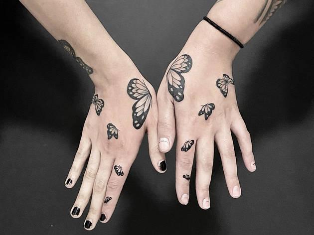 Butterfly Hand Tattoo (Uplift Tattoo)