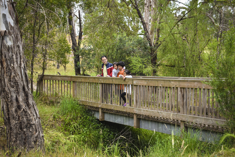 Family on bridge in Westerfolds Park