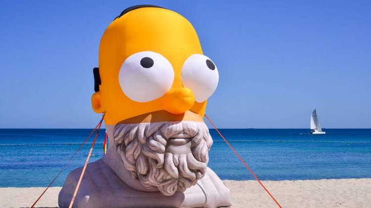 A huge inflatable that has a statue-likeness of ancient Greek poet Homer as its bottom half, and The Simpsons dad up top