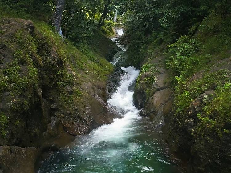 Slip down a natural rock waterslide