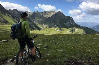 A man on a bike in the mountains in Switzerland.
