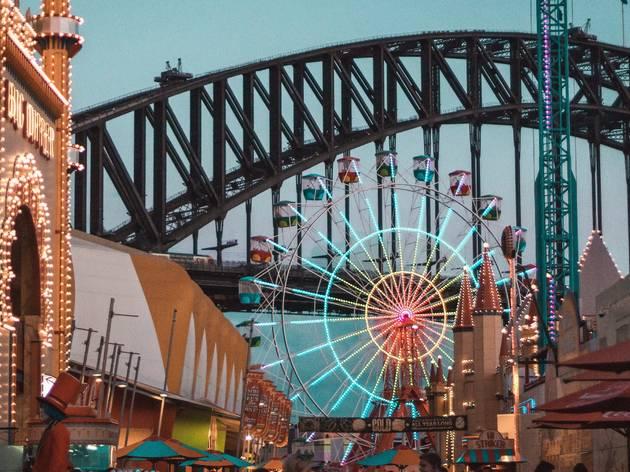 Ferris wheel in front of bridge