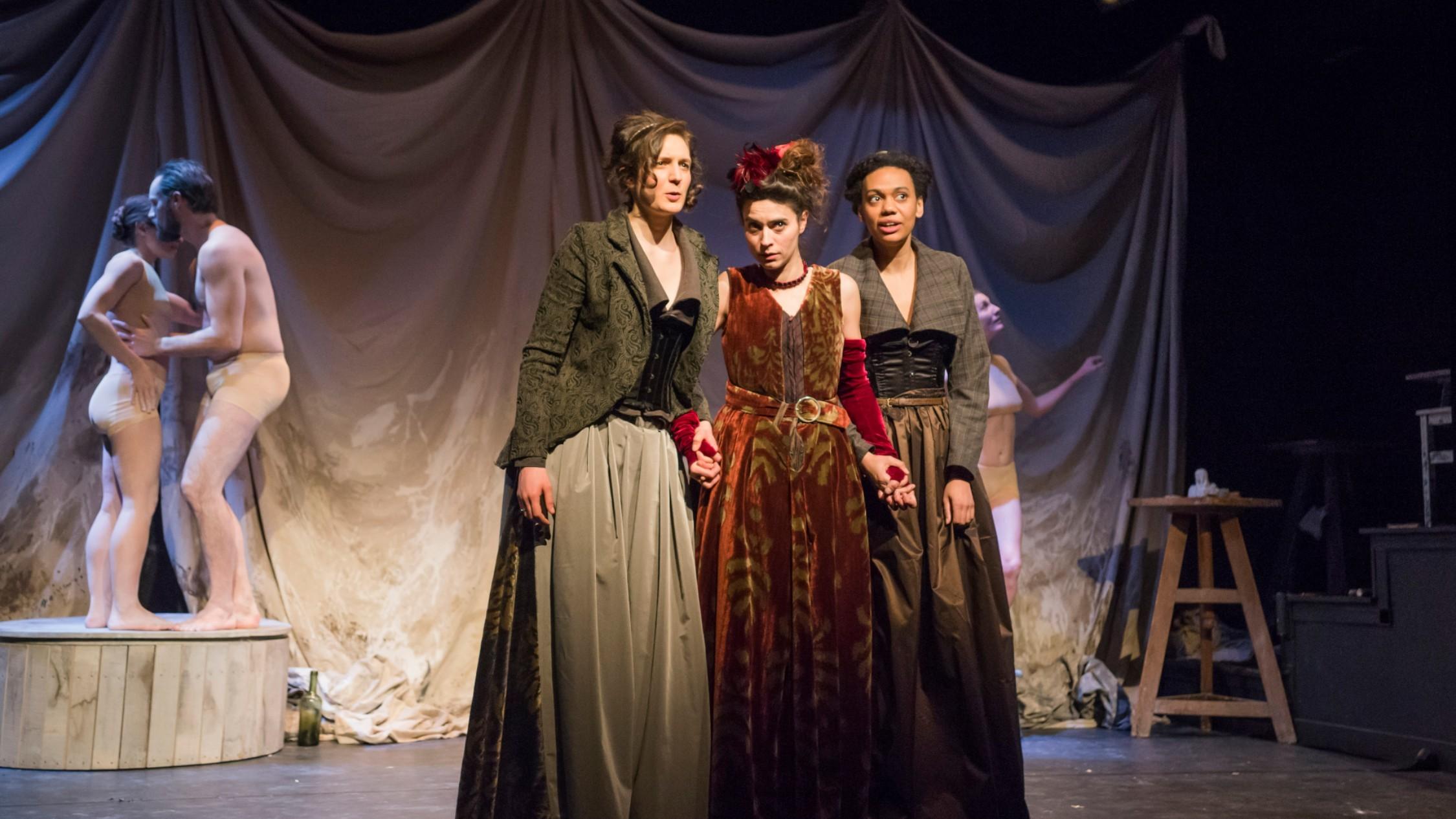 three women in 1800s Parisian attire