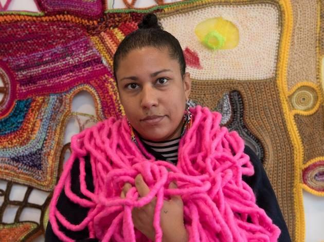 artist Paula do Prado wwearing neon pink textile art