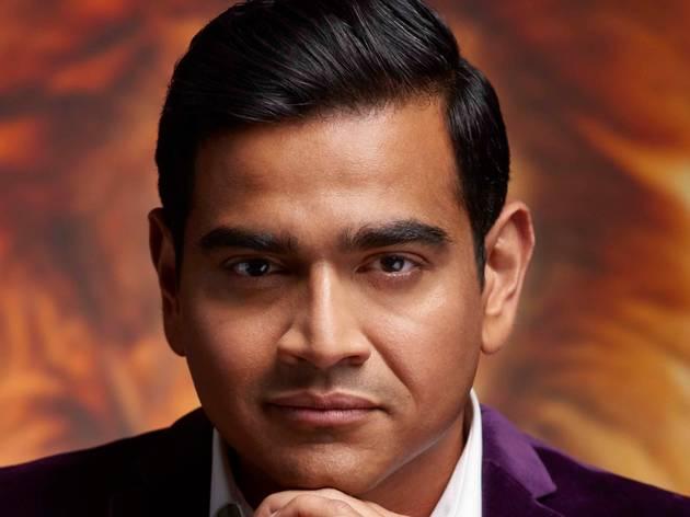 A close-up of comedian Dilruk Jayasinha in a purple velvet jacket