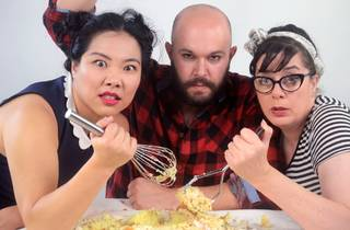 Three angry looking wannabe chefs mash some potatoes