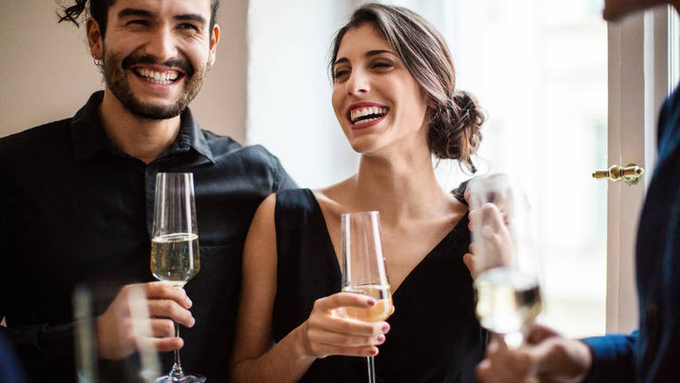 Amex Platinum Credit Card, Couple champagne flutes during dinner party
