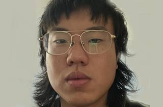 A close up of comedian Aaron Chen in glasses