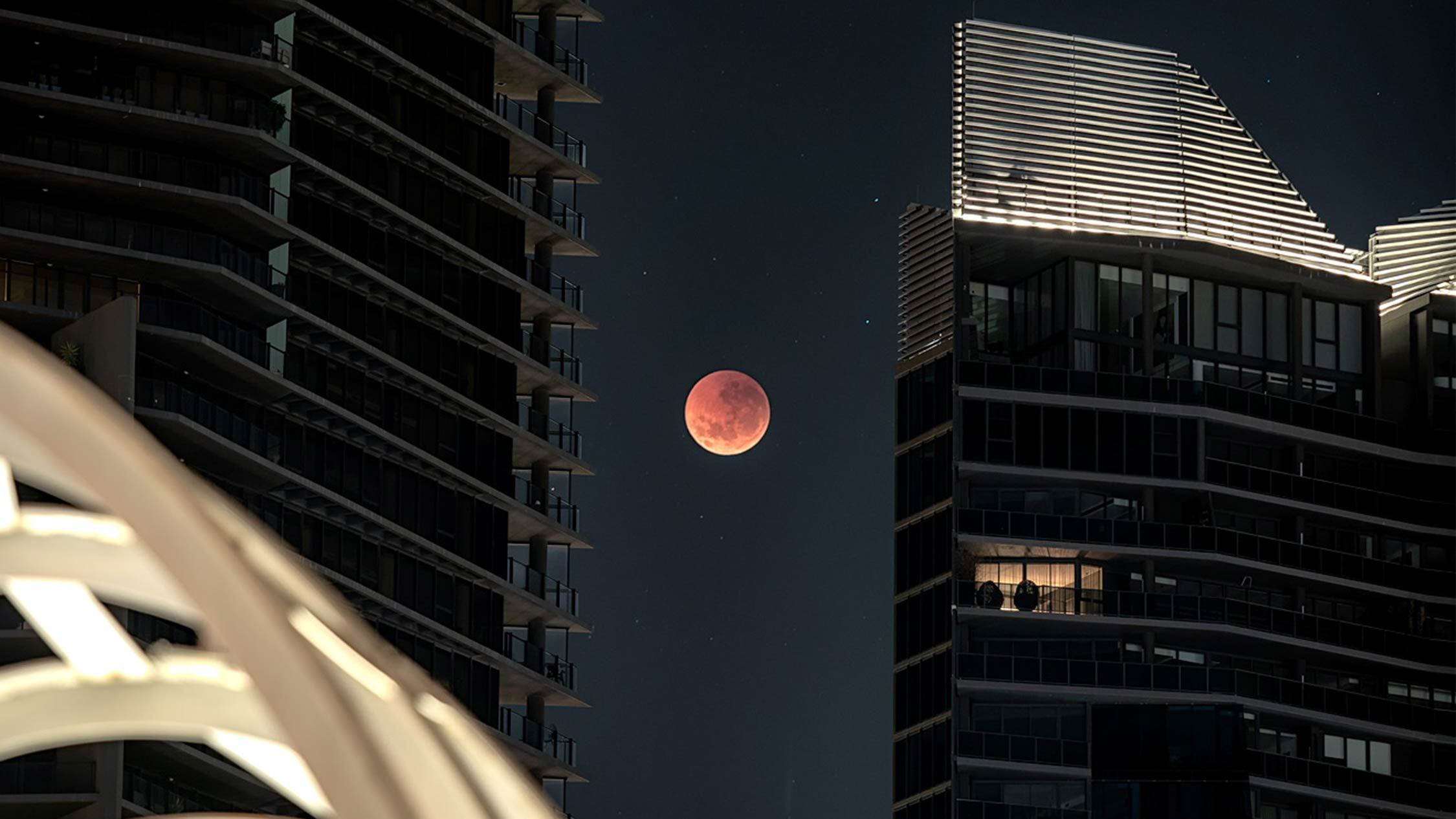 A large red moon over the Webb Bridge in Melbourne