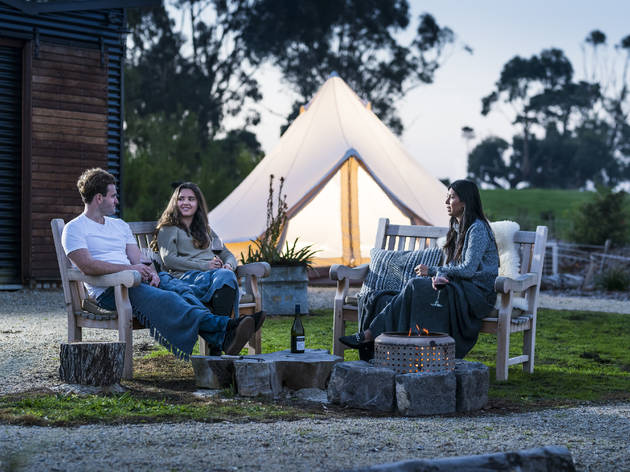 Relaxing around the fire at Inverloch Glamping Co.