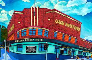 A beautiful, bright, postcard-like painting of the Barley Hotel