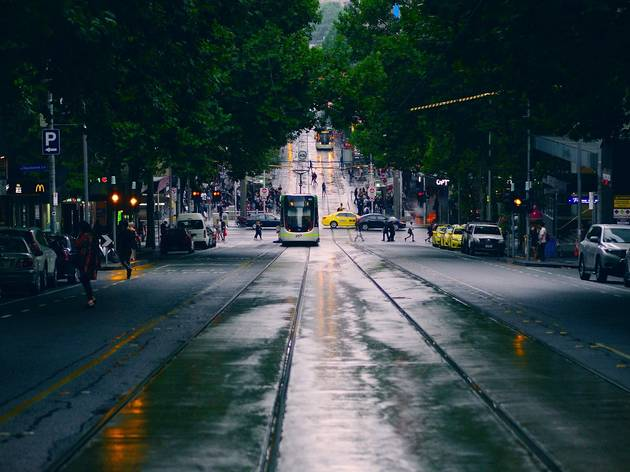 A wet day in Melbourne; a tram heads down Bourke Street, crossing the intersection at Elizabeth Street.