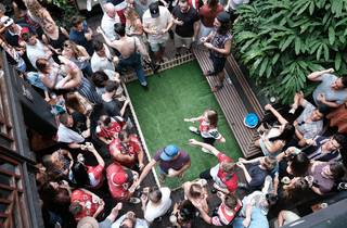 Aerial shot of people playing two-up.