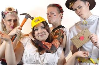 Four people dressed as ancient Greeks, but comedy style