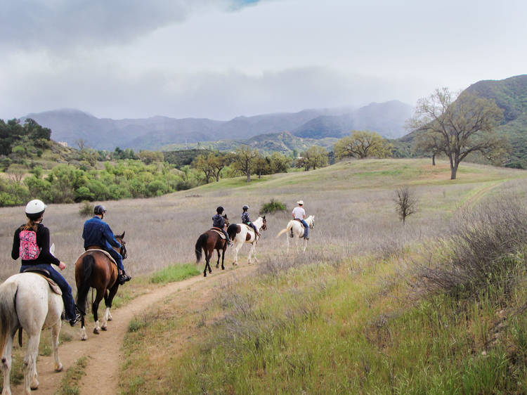 Trot through the mountains with Malibu Riders