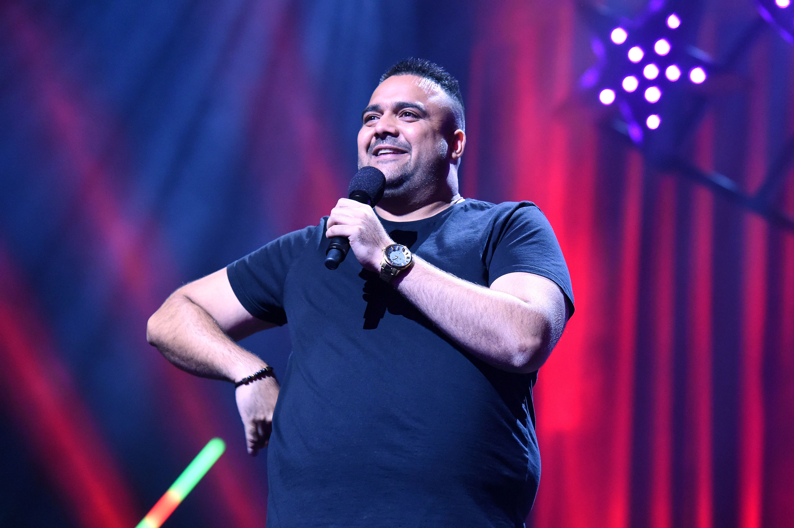 Comedian Dane Simpson performing on stage