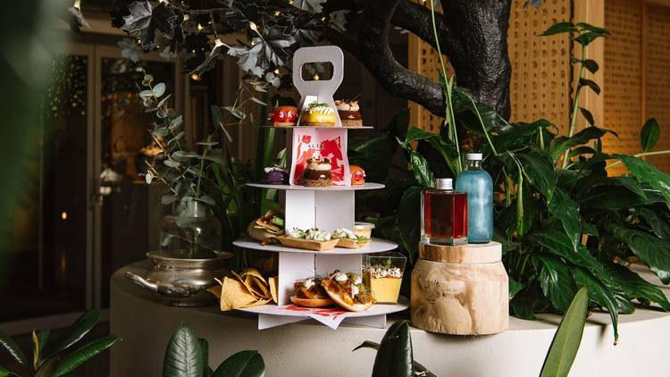 Cardboard tower contains a selection of sweet and savoury treats