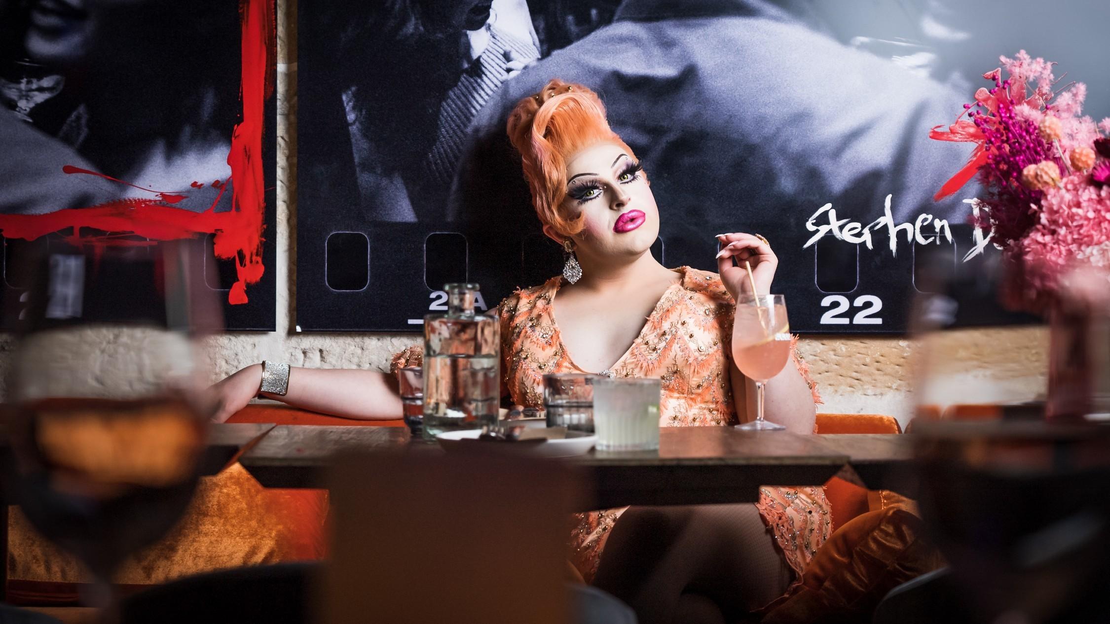Drag queen Hannah Conda sips cocktail