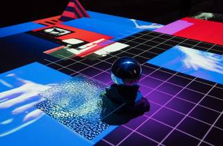 A cool digital work in bright red, blue and black with geometric shapes