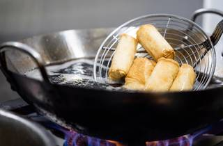 Lady's arm pastries are fried in wok