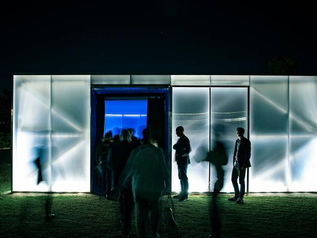 People mill around glowing audio-visual pop-up venue Blak Box